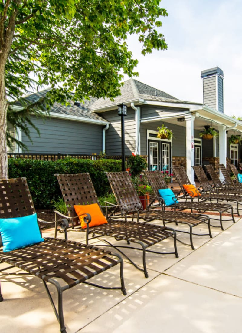 Lounge chairs lined up near outdoor cushioned couch at Marquis on Cary Parkway in Morrisville, North Carolina