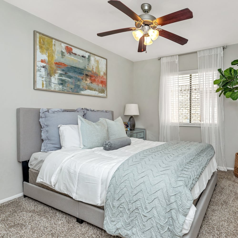 A bedroom with a large window for natural lighting at Barringer Square in Webster, Texas