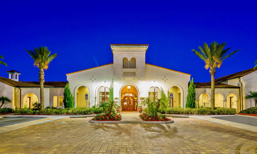 Evening view of the well-lit entrance exterior at Hacienda Club in Jacksonville, Florida