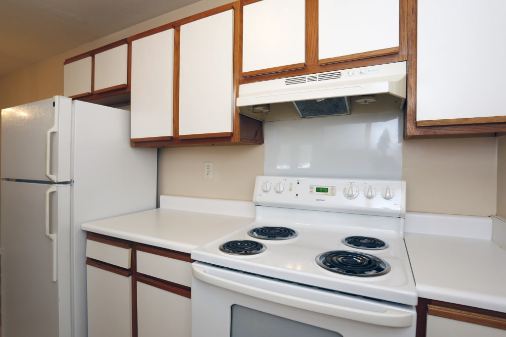 White kitchen appliances and cabinets at Ashton Park Apartments in Gulfport, Mississippi