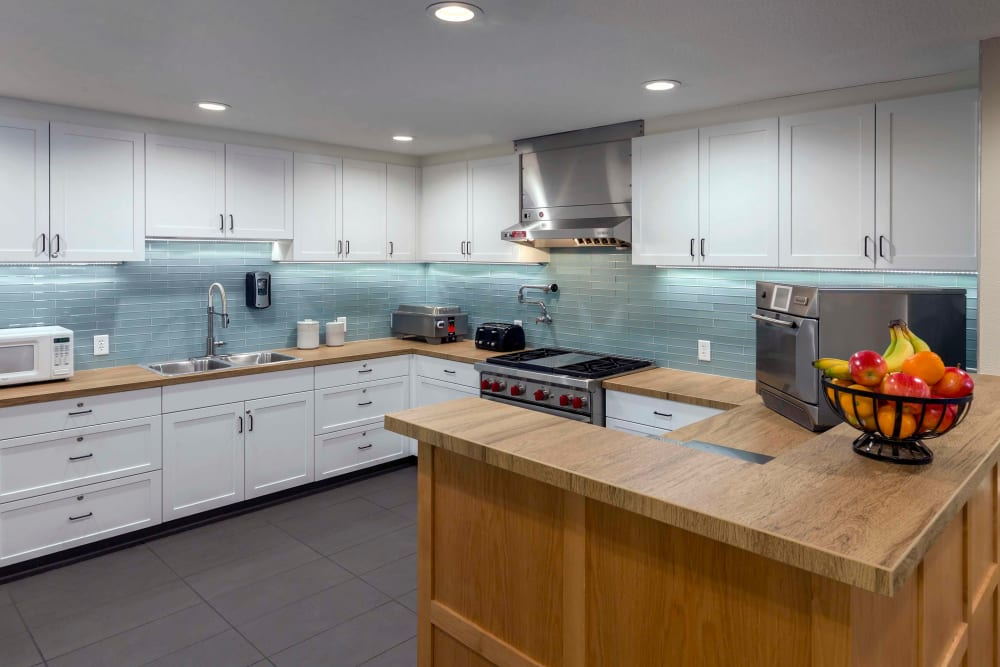 Clean, stylish kitchen with wooden countertops at The Springs at Clackamas Woods in Milwaukie, Oregon