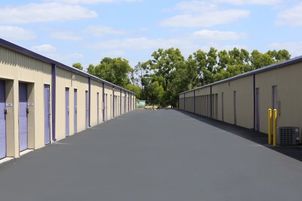 Storage units with purple doors at Midgard Self Storage in Jackson, Tennessee
