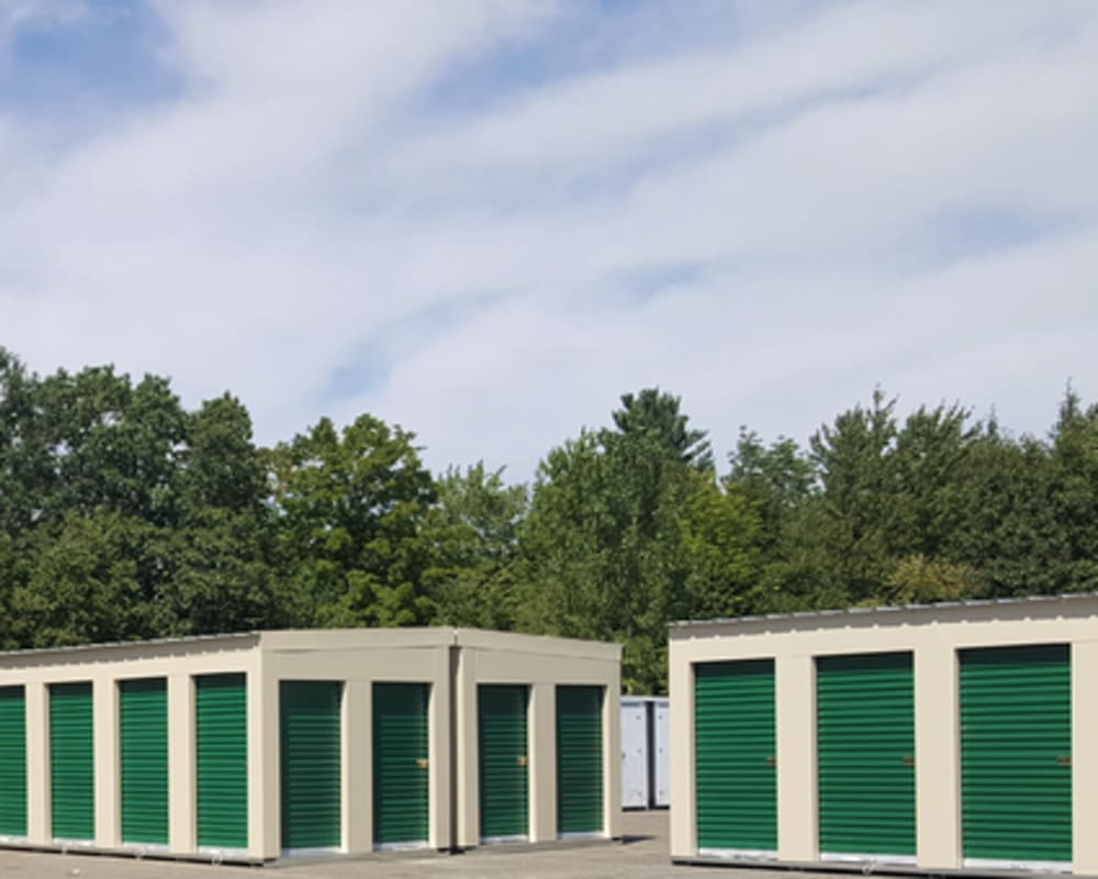 A row of outdoor units with green doors at 603 Storage - Candia in Candia, New Hampshire