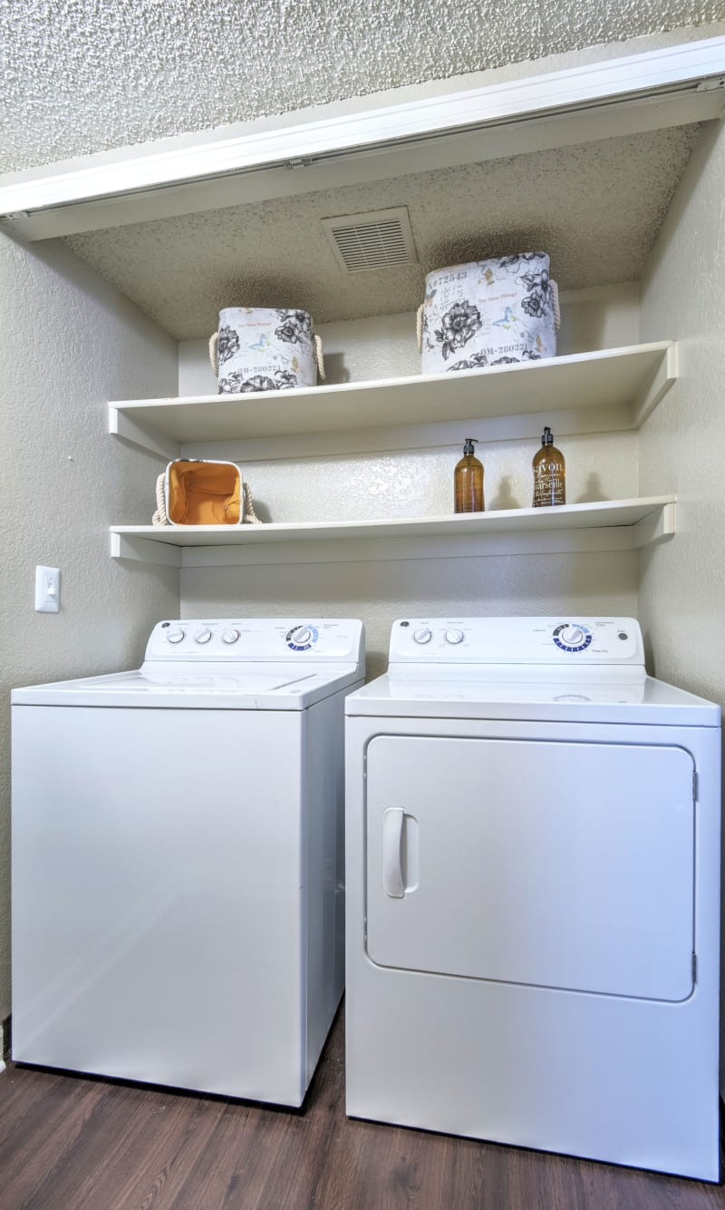 full sized side by side washer and dryer at Arapahoe Club Apartments