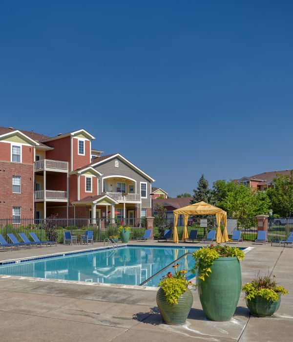 Swimming pool with lounges and cabanas at Bear Valley Park in Denver, Colorado