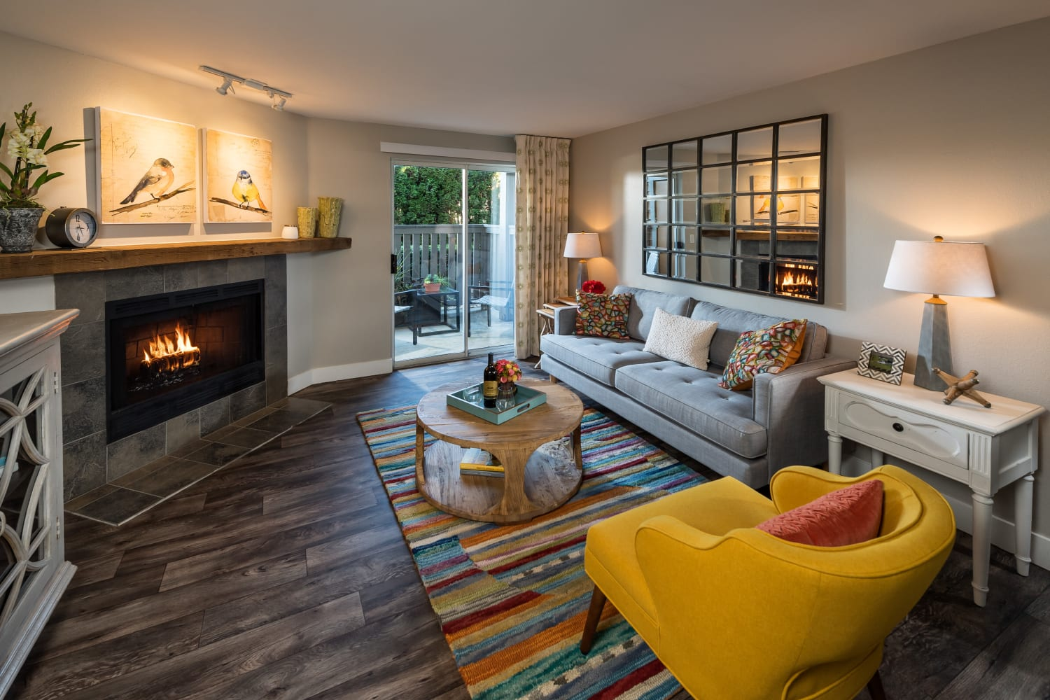 Large living room with fireplace at Campbell Run Apartments in Woodinville, Washington