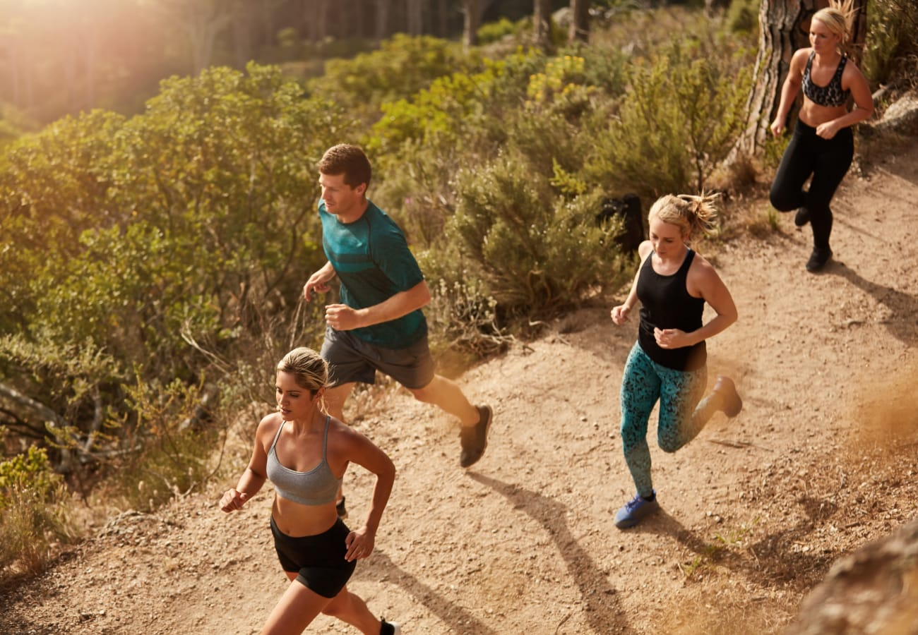 People on a run at Box Springs Mountain Reserve Park near The Trails at Canyon Crest in Riverside, California