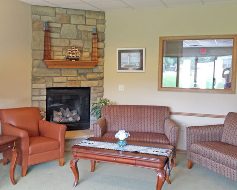 Cozy sitting room with fireplace at Arbor View in Burlington, Wisconsin.