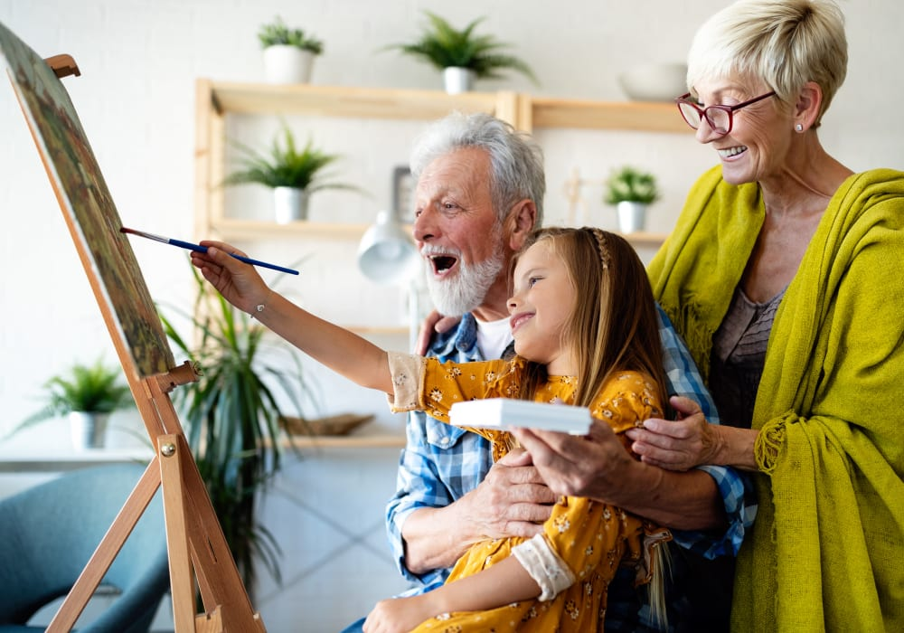 Residents painting with their granddaughter at The Vista in Esquimalt, British Columbia