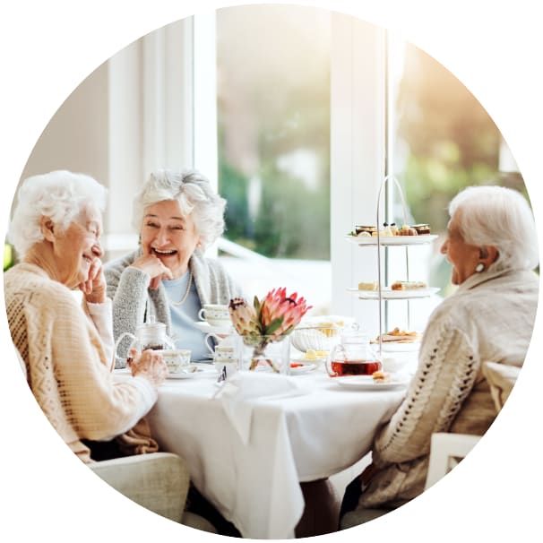 Residents sitting at a table eating at a Ebenezer Senior Living community
