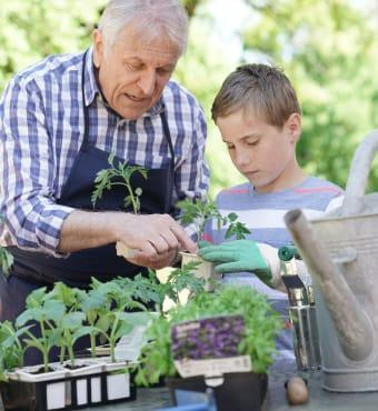 Resident and grandson gardening at Lassen House Senior Living in Red Bluff, California