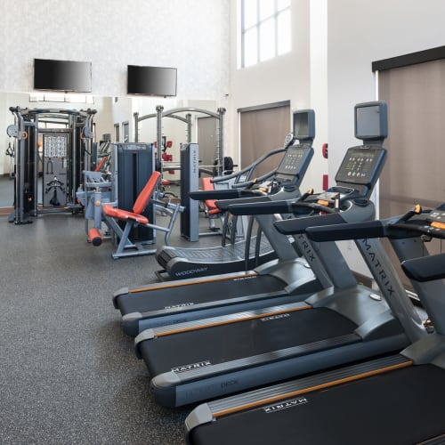 Well-equipped onsite fitness center at Olympus Auburn Lakes in Spring, Texas