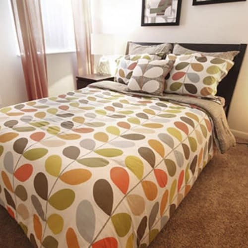 Model bedroom with plush carpeting at Lakeside Landing Apartments in Lakeside Park, Kentucky