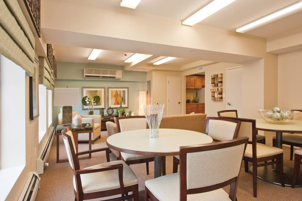 Community dining tables at Markham Gardens in Staten Island, New York