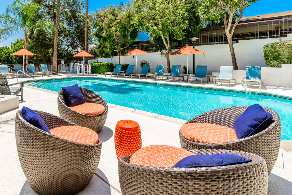 Comfortable poolside seating at Sonora at Alta Loma in Alta Loma, California