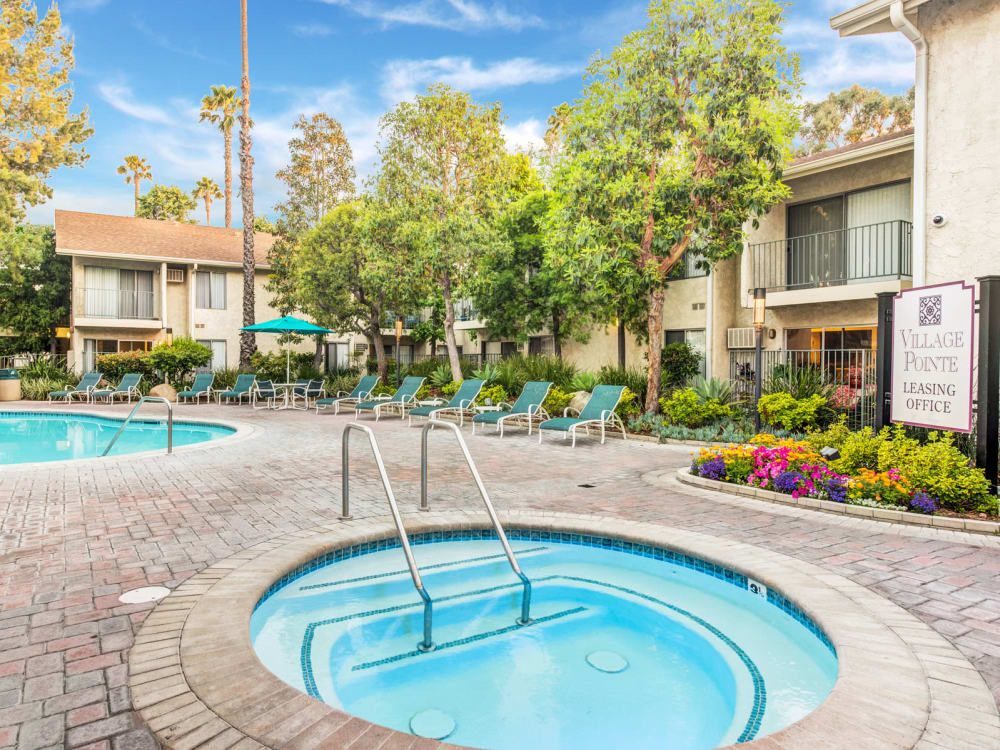 Spa near the swimming pool surrounded by mature trees at Village Pointe in Northridge, California