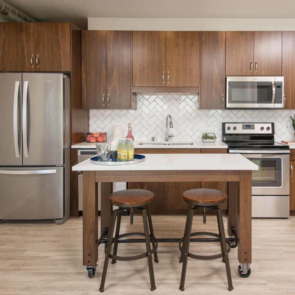 Quartz countertops and stainless-steel appliances in a model home's kitchen at Oaks Union Depot in St. Paul, Minnesota