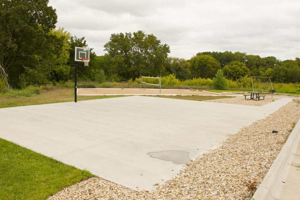 A basketball court that is great for entertaining at Highland Ridge Apartments in Manhattan, KS