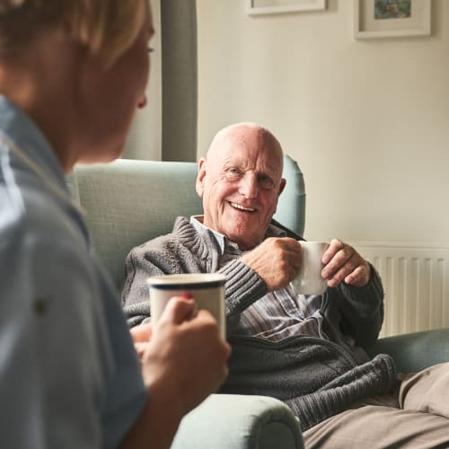 A gentleman having a discussion with staff from At Home Care Group in Oregon