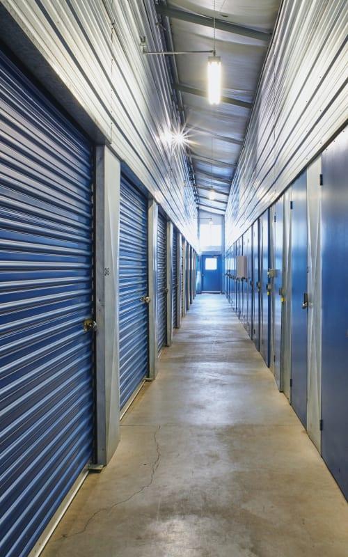 Interior storage units with blue doors at Sherlock Self Storage in Wilsonville, Oregon