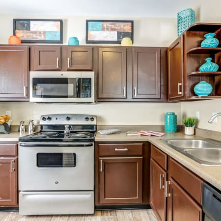 Renovated brown kitchen cabinetry at Skyecrest Apartments in Lakewood