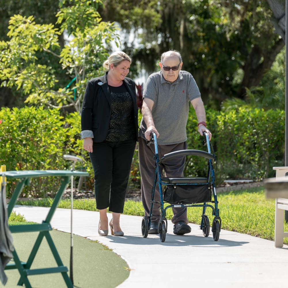 A resident and his daughter out for a stroll at an Inspired Living community.