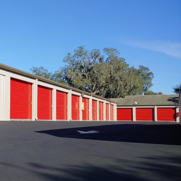 Outdoor storage units with red doors at StorQuest Self Storage in Clearwater, Florida