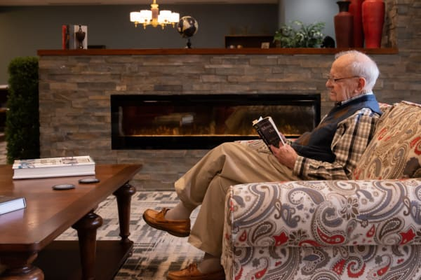 A resident reading a book at Aurora on France in Edina, Minnesota.