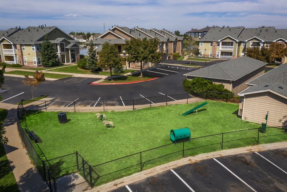 Have fun with your furry friend in the dog park at Gateway Park Apartments in Denver, Colorado
