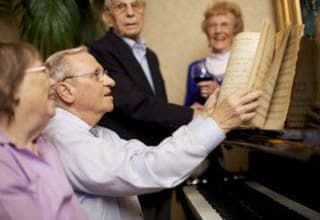 Senior living residents playing music at Discovery Commons