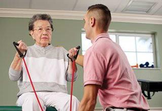 Senior living resident in Oak Park Villages Senior Living doing exercise