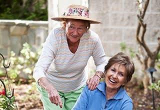 Senior living residents gardening outdoors in New Orleans