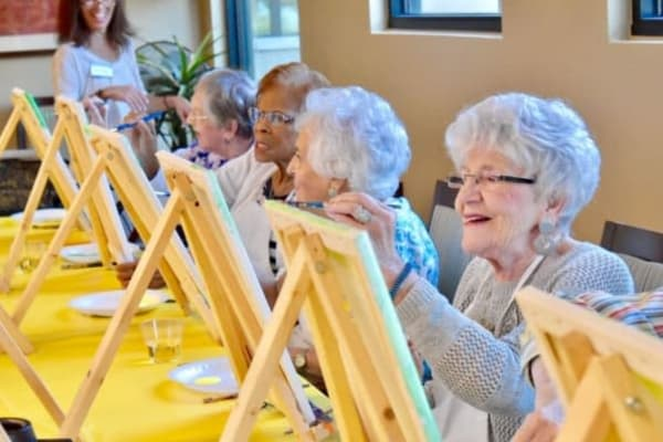 Residents painting at Sunset Lake Village Senior Living in Venice Florida