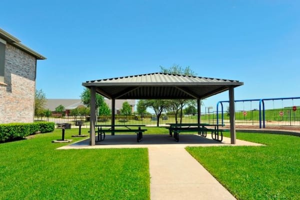 Outdoor community space with pavilion at The Springs of Indian Creek in Carrollton, Texas