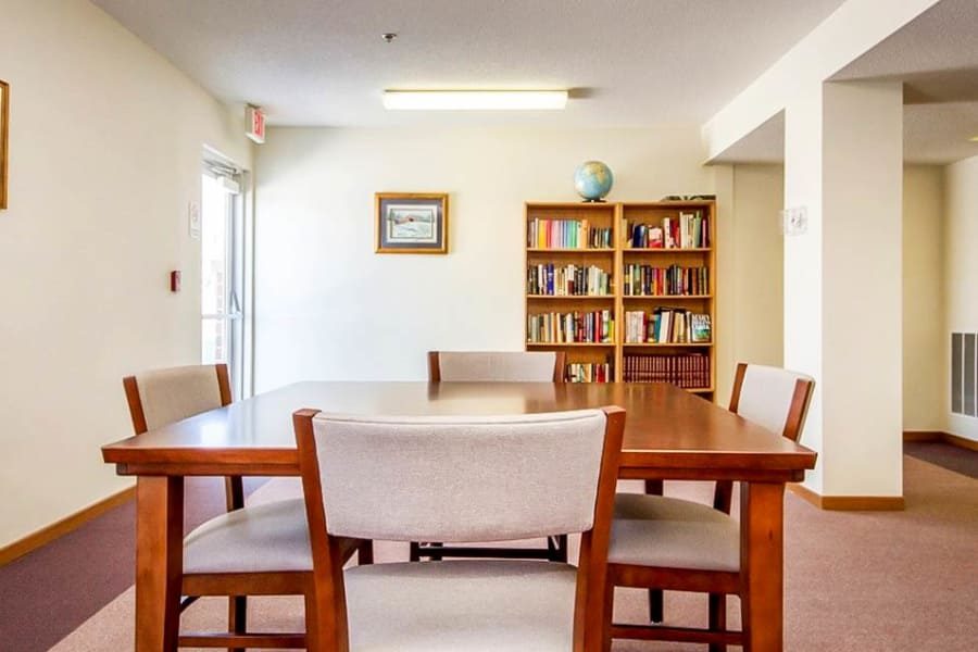 Common room and bookshelf at Regency Heights in Iowa City, Iowa