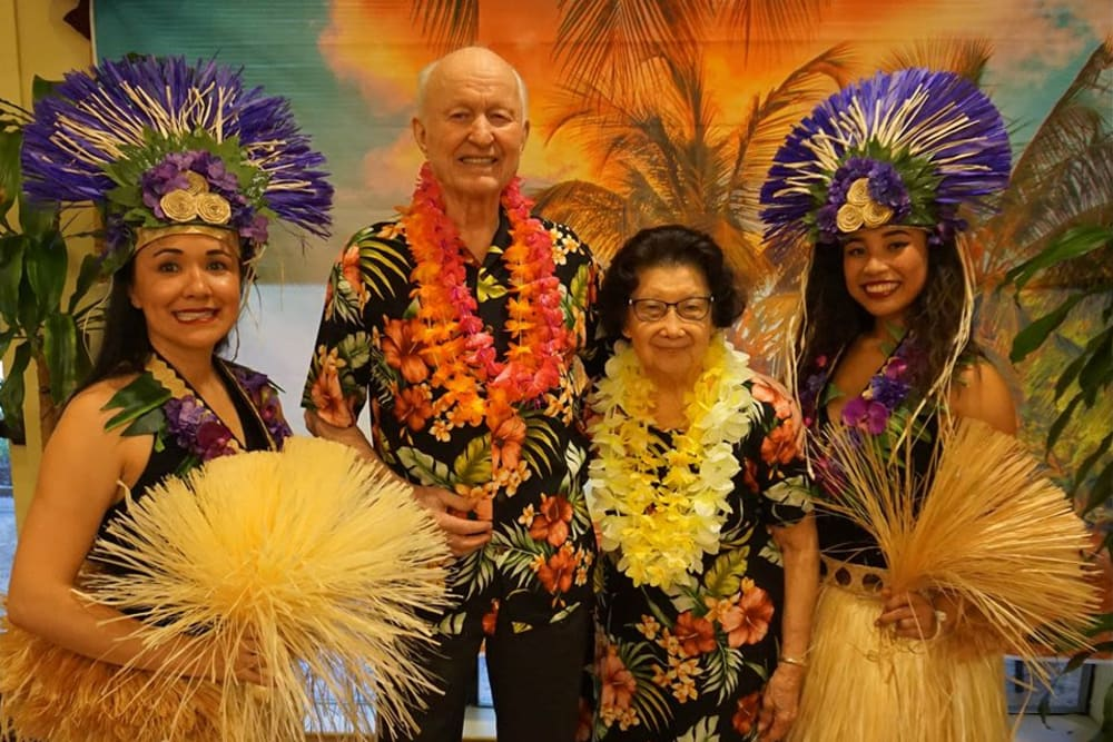 Resident enjoying a Luau party at Winding Commons Senior Living in Carmichael, California