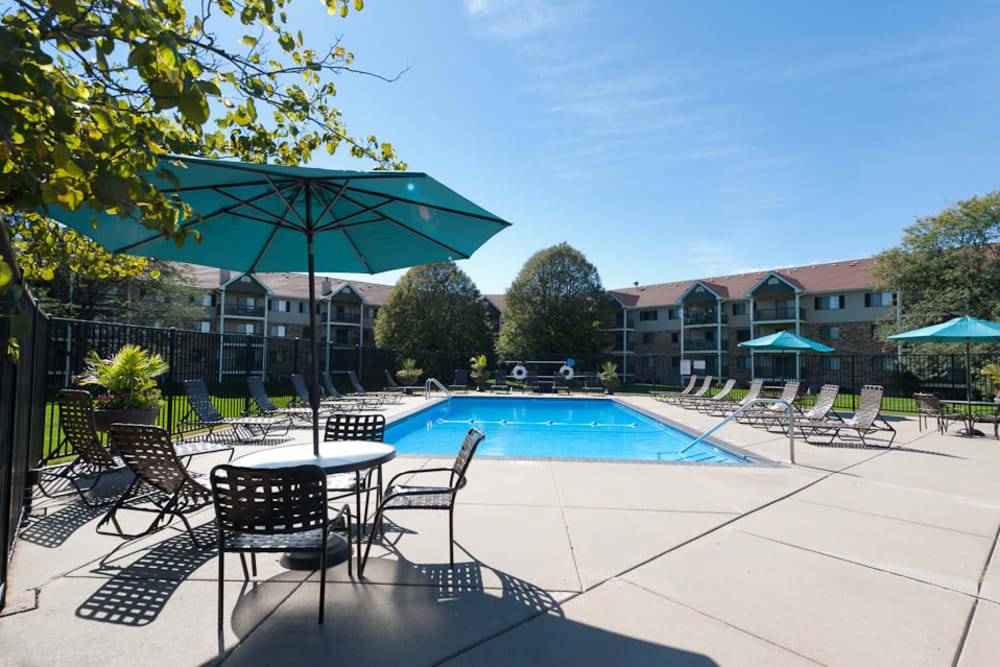 Outdoor pool with sundeck at Pointe West Apartment Homes in West Des Moines, Iowa