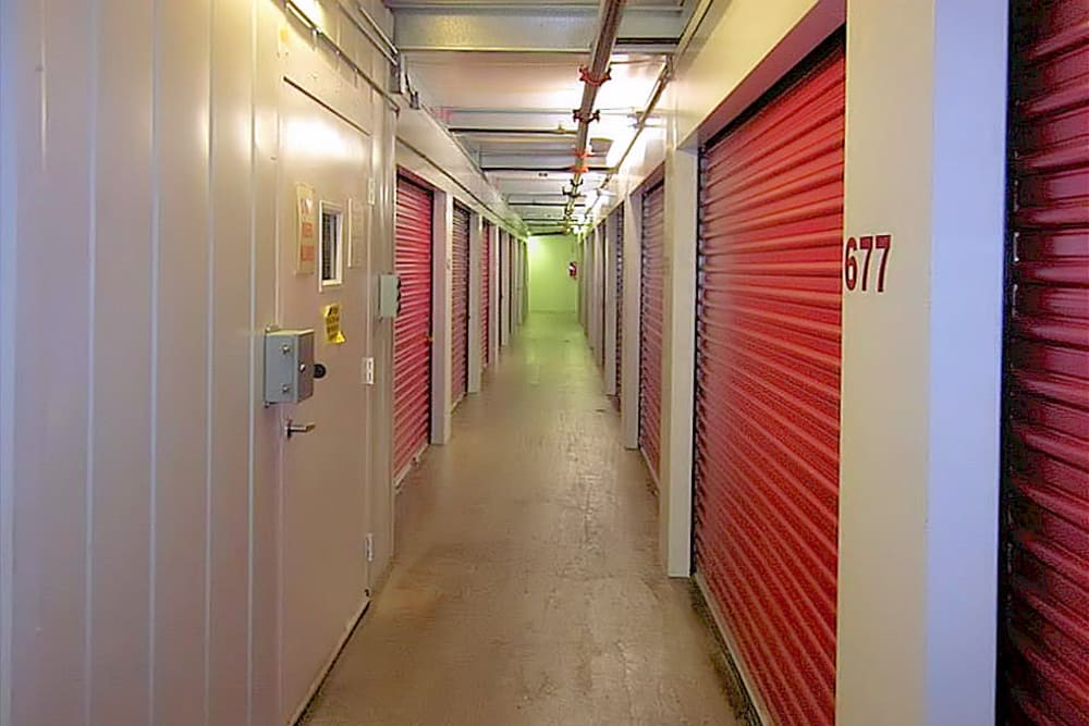 Indoor hallway of storage units at A Space Place Self Storage in Medford, New York