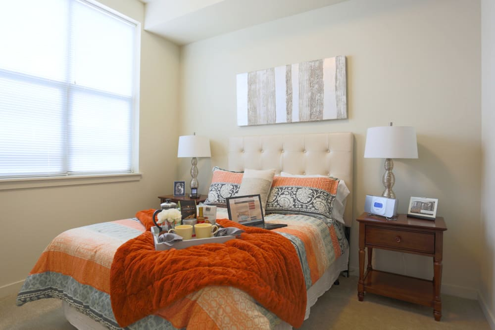 Brightly lit large bedroom in apartment at The Lofts at Glenwood Place in Vancouver, Washington