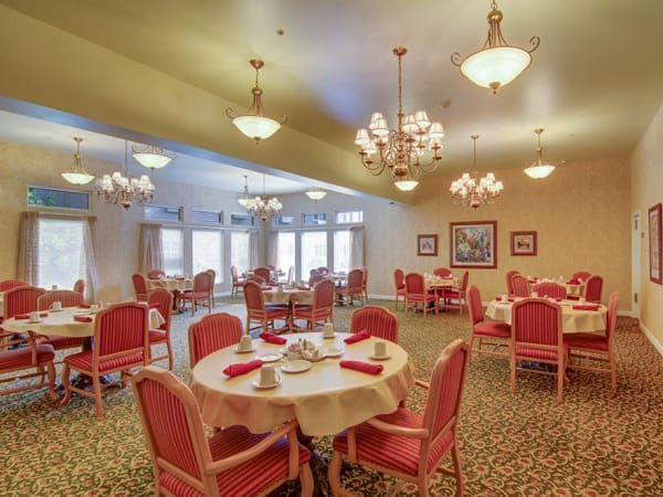Elegant restaurant-style dining with round tables and comfortable seating at Randall Residence of McHenry in McHenry, Illinois