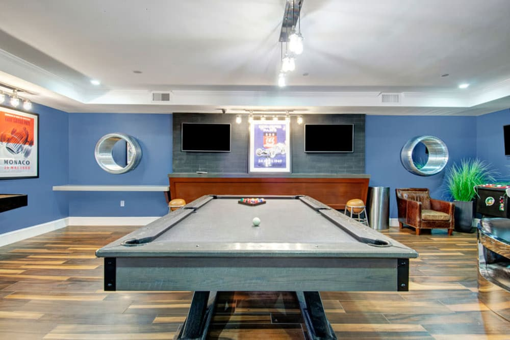 Billiards table and game area inside clubhouse at Bradlee Danvers in Danvers, Massachusetts