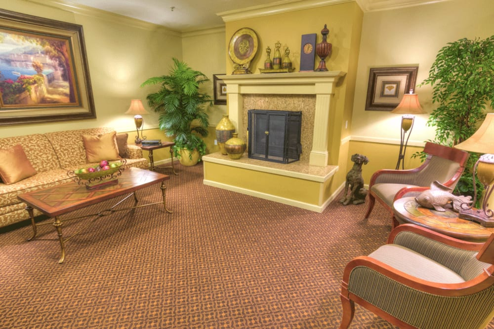 Comfortable and cozy fireside lounge at The Meadows - Assisted Living in Elk Grove, California