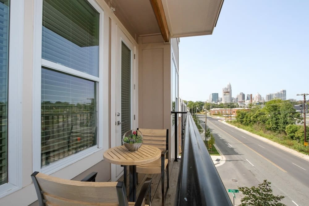 Private balcony with view of skyline at 300 Optimist Park in Charlotte, North Carolina