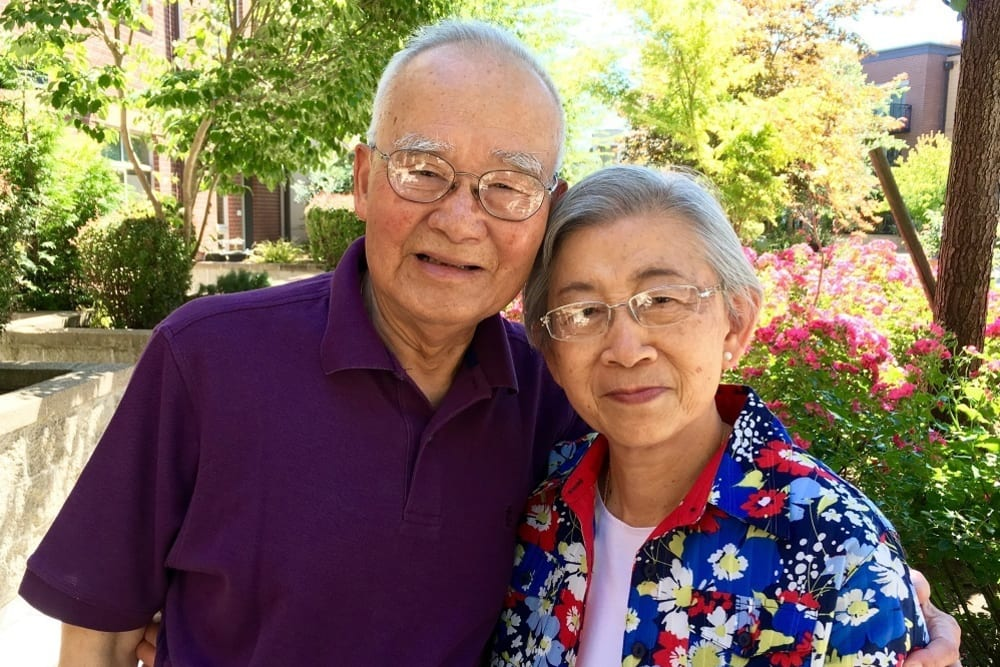 Happy resident couple at Merrill Gardens at The University in Seattle, Washington.