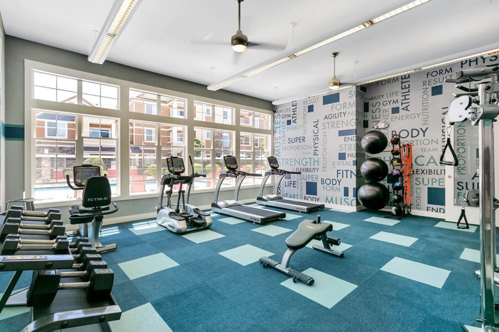 Fitness center with plenty of individual workout stations at Crestone Apartments in Aurora, Colorado