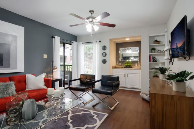 Cozy living room with porch access at Circle at Point Park in Houston, Texas