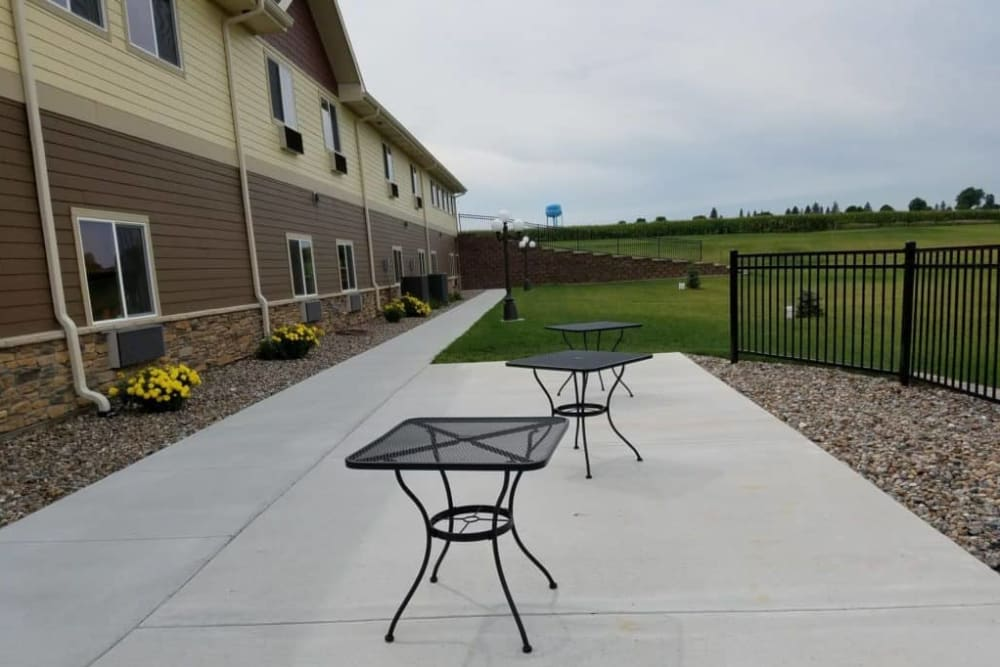 Exterior view of apartment buildings and patio at Manning Senior Living in Manning, Iowa.