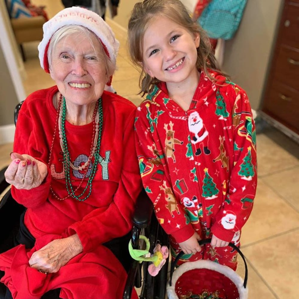 A resident and granddaughter celebrating the holiday at Inspired Living Ivy Ridge in St Petersburg, Florida.