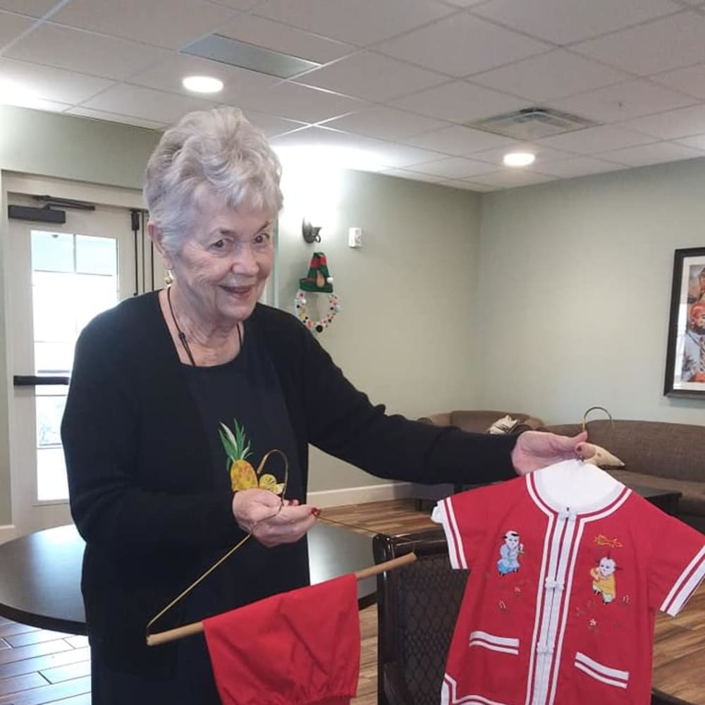 A resident showing off clothes at Inspired Living Kenner in Kenner, Louisiana.