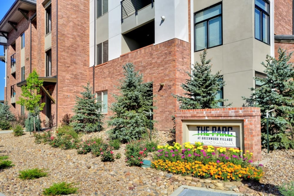 Exterior of The Parc at Greenwood Village surrounded by lush landscaping in Greenwood Village, Colorado